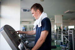 Healthy man a treadmill Stock Photography
