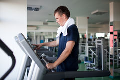 Healthy man a treadmill Stock Image