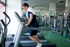 Healthy man a treadmill Royalty Free Stock Images