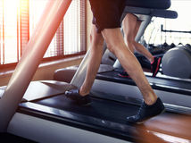 Healthy man and woman running on a treadmill Royalty Free Stock Images