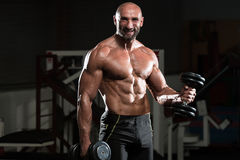 Healthy Man Working Out Biceps In A Health Club Stock Photo