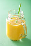 Healthy mango pineapple smoothie in mason jars.  Stock Photography