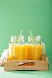 Healthy mango pineapple smoothie in mason jars Royalty Free Stock Image