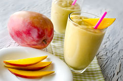 Healthy mango tropical smoothie horizontal Stock Images
