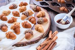 Healthy Maple Acorn Cakelets, acorn shape cookies on wood slice serving board, tray. Healthy Maple Acorn Cakelets, acorn shape cookies on wood slice serving Stock Photography