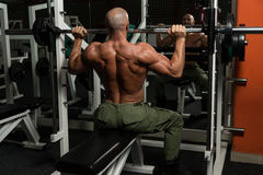 Healthy Mature Man Doing Exercise For Shoulder Stock Image
