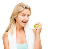 Healthy mature woman exercise green apple isolated on white back Stock Photos