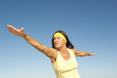 Healthy mature woman exercising outdoor  Stock Images