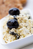 Healthy meal of feta cheese, bread and olives Stock Photography