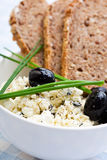 Healthy meal of feta cheese, bread and olives Stock Image