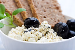 Healthy meal of feta cheese, bread and olives Stock Images