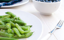 Healthy meal with green beans and blueberry Royalty Free Stock Photography