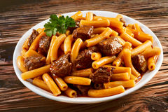 Healthy meal of Italian rigatoni noodles with beef Stock Photography
