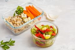 Healthy meal prep containers with brown rice, tofu and vegetable