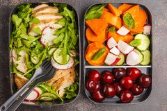 Healthy meal prep containers with grilled chicken with salad, sw