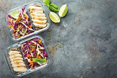 Healthy meal prep containers with quinoa and chicken. Healthy meal prep containers with quinoa, chicken and cole slaw overhead shot with copy space Royalty Free Stock Images