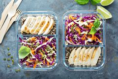 Healthy meal prep containers with quinoa and chicken. Healthy meal prep containers with quinoa, chicken and cole slaw overhead shot royalty free stock images
