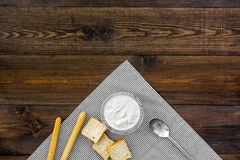 Healthy meal. White mushroom cream soup served with rusks on dark wooden background top view copy space. Healthy meal. White mushroom cream soup served with Stock Photos