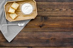 Healthy meal. White mushroom cream soup served with rusks on dark wooden background top view copy space. Healthy meal. White mushroom cream soup served with Royalty Free Stock Photo