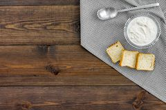 Healthy meal. White mushroom cream soup served with rusks on dark wooden background top view copy space. Healthy meal. White mushroom cream soup served with Royalty Free Stock Image