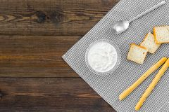 Healthy meal. White mushroom cream soup served with rusks on dark wooden background top view copy space. Healthy meal. White mushroom cream soup served with Royalty Free Stock Photography