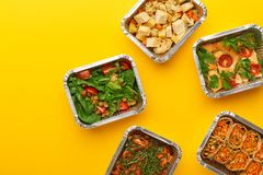 Healthy meals delivery. Eating right concept, copy space, top view. Healthy meals delivery. Casserole, vegetarian rolls, fresh and baked vegetables salads in stock photo