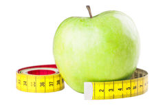 Healthy measurements. Fit food on white background Royalty Free Stock Photography