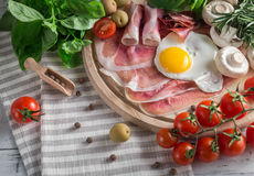 Healthy Mediterranean breakfast ingredients, ham, fried eggs, to Royalty Free Stock Photography