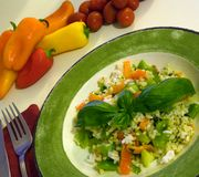 Healthy mediterranean salad. Photograph of a healthy low-calorie Mediterranean salad dish with rice, fresh vegetables and herbs Stock Photo