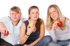Healthy Meeting. Three teenage girls eating apples Stock Photos