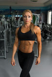 Healthy Middle Age Woman With Six Pack. Mature Woman Standing Strong In The Gym And Flexing Muscles - Muscular Athletic Bodybuilder Fitness Model Posing After Royalty Free Stock Photography