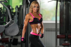 Healthy Middle Age Woman With Six Pack. Portrait Of A Mature Physically Fit Woman Showing Her Well Trained Body - Muscular Athletic Bodybuilder Fitness Model Stock Photos