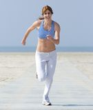 Healthy middle aged woman enjoying a jog Stock Image
