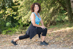 Healthy middle aged woman stretching before Fitness and Exercise Royalty Free Stock Image