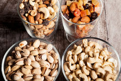 Healthy mix of dried nuts and sweets in was glass Royalty Free Stock Photos