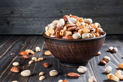 Healthy mix nuts on wooden background. Almonds, cashews, peanuts Royalty Free Stock Photography