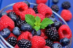Healthy mixed fruit and ingredients with raspberry, blueberry, blackberry stock images
