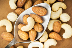 Healthy mixed nuts closeup Stock Photos