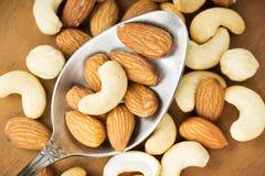 Healthy mixed nuts closeup Stock Photos