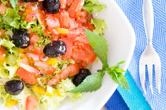 Healthy mixed salad garnished with olives Royalty Free Stock Photos