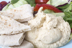 Healthy Mixed Salad with houmous and pitta bread Royalty Free Stock Images