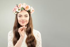 Healthy Model Woman with Clear Skin, Curly Hair, Makeup and Rose Flowers Wreath.  royalty free stock images