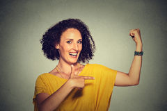 Healthy model woman flexing muscles confident showing her strength. Closeup portrait fit middle aged healthy model woman flexing muscles confident showing her Royalty Free Stock Photos