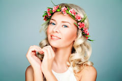 Healthy Model Woman wearing Flower Wreath. Beautiful Woman making Heart. Summer Beauty, Facial Treatment and Cosmetology Concept Stock Photography