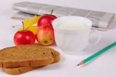 Healthy morning snack. Bread with milk and apples against a morning paper removed close up Stock Photos