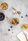 Healthy morning with yogurt, muesli and berries table ground top view Royalty Free Stock Images