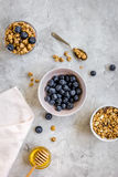 Healthy morning with yogurt, muesli and berries table ground top view Stock Photography