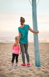 Healthy mother and baby girl on beach Stock Image