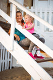 Healthy mother and baby girl sitting on stairs Stock Image