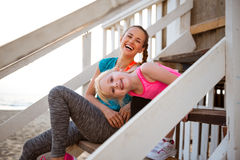 Healthy mother and baby girl sitting on stairs Royalty Free Stock Photos